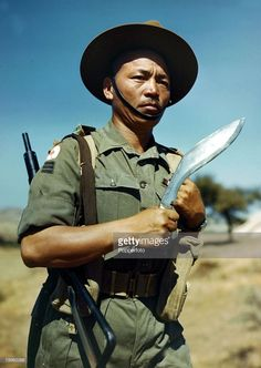 Havildar (sergeant) Kul Bahadur Gurung, of a Gurkha regiment of the 23rd Indian Infantry Division of the British Army, holding the traditional kukri knife, World War II, February 1945. He is possibly part of the 3rd Battallion, 5th Royal Gurkha Rifles.