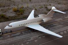 happy design studio wraps private jet in gradient stripe pattern. http://www.thrivesolo.com
