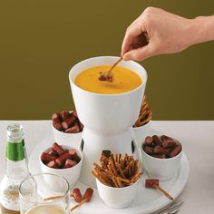 Beer & Cheddar Fondue Recipe -This great-tasting fondue is my mom's favorite, so I make it for her birthday every year. I like to serve it with apple slices, rye bread cubes and chunks of carrots, mushrooms, celery, zucchini, squash and broccoli. —Amanda Wentz, Virginia Beach, Virginia