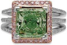 A 3.04 carat fancy intense green diamond offset by pavé pink diamonds in a ring by L.J. West Diamonds