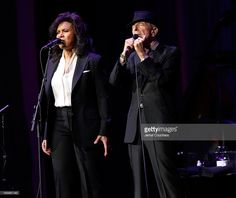 Singer/musician Leonard Cohen (R) performs at Radio City Music Hall on April 6, 2013 in New York City.
