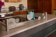 Contemporary Kitchen with glass splash guard behind stove