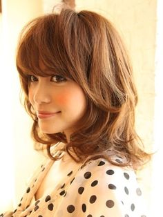 Super cute hair with thick bangs. I've learned from experience that I can't do bangs, but someone out there can!