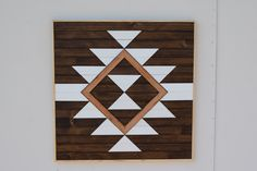 Large Wood Wall Art - Native Southwestern Everlasting Life Wood Wall Piece - Reclaimed Oak Inlay with White and Brown Wood Art Wall Hanging by RoamingRootsWoodwork on Etsy https://www.etsy.com/listing/249153441/large-wood-wall-art-native-southwestern