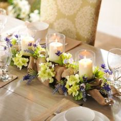 Make any table feel like a country garden with this Lavender Burlap Centerpiece. The purple and green shades will bring new light to any table setting! #kirklands #SpringisintheAir