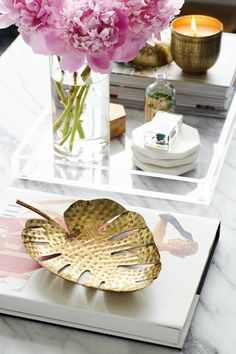 From the addition of books, flowers and trays, here is our complete guide on how to style the perfect coffee table.