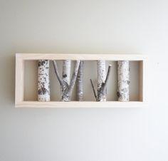 What is it about birches that draws us in?  Natural white birch forest wall art - and many more COOL pieces by urbanplusforest on Etsy. (good prices, too)