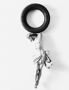 Paolo Canevari, Jesus, 1999, 18th century wooden sculpture, tire