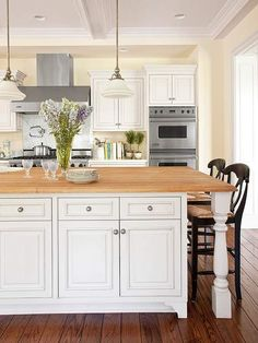 Shaker painted cream kitchen cabinets dark island for Cheap kitchen cabinets houston tx