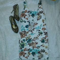 Flower dress Beautiful flower white dress. Only worn once! Like  brand new. Cute for spring and summer. Adorable and comfy. Perfect condition Dresses Midi