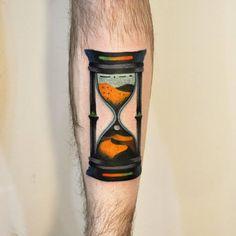 Hourglass tattoo on Chris' left shin.
