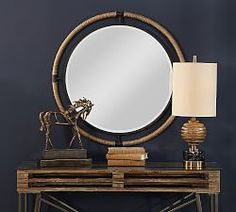 This forged iron mirror frame is finished in a textured rust black that's wrapped in natural rope bringing a coastal feel to any room. The round mirror is surrounded by a generous 1 bevel. W X 36 H X 1 D (in) Round Mirror With Rope, Round Hanging Mirror, Rope Mirror, Round Wall Mirror, Round Mirrors, Beaded Mirror, Large Mirrors, Wall Mirrors, Coastal Mirrors
