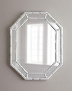 "Bamboo-textured mirror. Resin frame. High-gloss white finish. Hooks on back for hanging. 25.5""W x 3""D x 33""T. Imported."