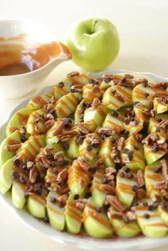 Apple Nachos~ Slice green apples, (squeeze lemon juice on the slices so they don't brown) coat with carmel sauce, mini chocolate chips and top with crushed walnuts!