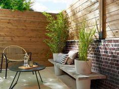 Une clôture mi-bois, mi-brique pour un jardin ultra cocoon - Un jardin delimité pour plus d'intimité