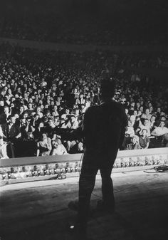 Elvis performing at the Municipal Auditorium in Amarillo, Texas, on April 13, 1956. Photo by A.Y. Owen.