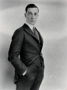 Buster Keaton 1920s  (DB peak lapel and extreme jetting on side pockets)