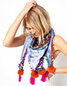 Tye dye a large square of white or light colored jersey. Sew on multiple strands of pom pom trim to the edge, in bright contrasting colors.