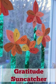 Gratitude flower sun catcher craft for displaying the things your kids are thankful for.