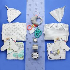 Twins Baby Hamper, Luxury by The Baby Hamper Company is a bright and modern baby gift for baby boy or girl twins! Filled with luxury clothes, toys and gifts for mum! #babyhampers #babygifts #babyboygifts #babygirlgifts #babyshowergifts #babygiftsuk #babyboyhamper #babygirlhamper #babyshowerhamper #bestbabygifts #genderneutralbabygift #funkybabygift #brightbabygift #unusualbabygift #uniquebabygift #twinbabygift #babyhampercompany Twin Baby Gifts, Unisex Baby Gifts, Best Baby Gifts, Newborn Baby Gifts, Baby Shower Presents, Baby Presents, Baby Shower Gifts, Baby Shower Hamper, Baby Gift Hampers