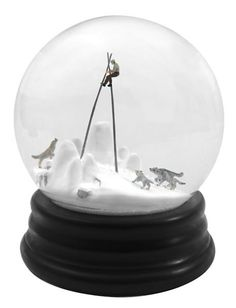 Snow globes filled with sinister scenes of people in peril