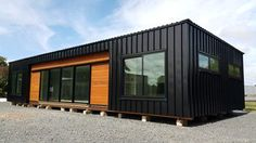 The secret to well designed container structures is good use of colors and smart, subtle mixing of other finishes and/or materials. Container Van House, Building A Container Home, Container Buildings, Container Architecture, Container House Design, Shed Homes, Prefab Homes, Modern Wooden House, Temporary Architecture