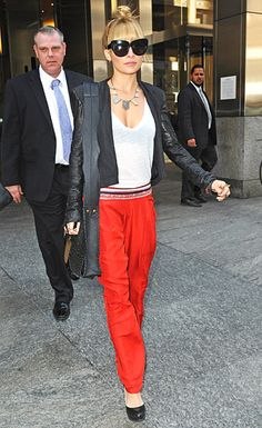Nicole Richie donned orange, jeweled harem pants and a leather jacket.
