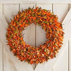 Orange Wood Curl & Twig Wreath - this inviting wreath is handcrafted of individually curled wood shavings made to look like colorful fall foliage with twig highlights all around. #affiliate