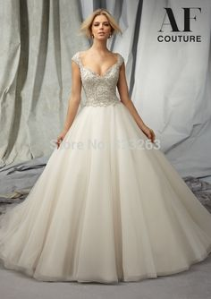 Cheap dresses celebrities, Buy Quality dresses paris directly from China dress jumpsuit Suppliers: Sparkly Cap Sleeves A Line Wedding Dresses 2014 Open Back with Extravagant Diamonds and Crystals Top LK066 &n