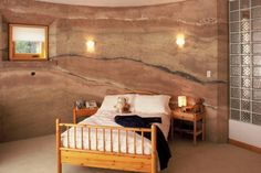 I just love the lines in the walls of this rammed earth home.  The walls look like polished marble or granite.
