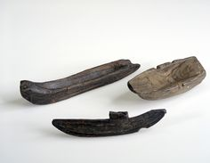 Toy wooden boats from Bryggen in Bergen, Norway. Dating to the medieval period. BRM_0/17766 / BRM_0/62798 / BRM_0/39900. Photograph by Svein Skare, Universitetsmuseet i Bergen.