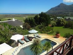 Wild Rose Country Lodge lies between the spectacular mountain Scenery and the shores of the Atlantic Ocean in Noordhoek Cape Town South Africa Western Cape. Cape Town Accommodation, Cape Town Holidays, Cape Town South Africa, Atlantic Ocean, Sun Lounger, Competition, Scenery, Patio, Country