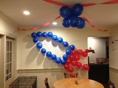 Rocketship made out of balloons taped to the wall for Henry's birthday.