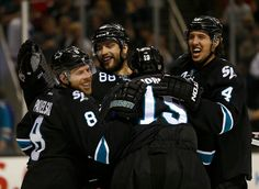 San Jose Sharks forwards Joe Pavelski, Joe Thornton and defensemen Brent Burns and Brenden Dillon are all smiles after Pavelski's second goal put the Sharks ahead of the Boston Bruins 6-4 (Dec. 4, 2014).