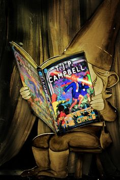 elf mockup of elf reading T. J. P. CAMPBELL's Planet of the Girls