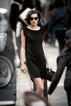 The Little Black Dress, sleeveless, boat neck, skims the body, rich fabric