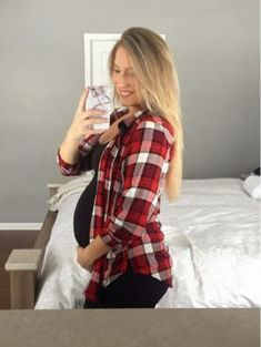 Beautiful mom wearing flannel over a black maternity top and leggings. - - Beautiful mom wearing flannel over a black maternity top and leggings. The perfect outfit for a fall pregnancy.