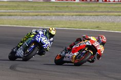 Marc Marquez and Valentino Rossi fight for the victory