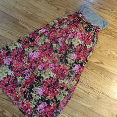 Maxi Dress Strapless maxi dress. Super comfy. From target last summer or summer before. Adorable! Top part it black and white. Has some polling as shown in last photo right under arms. Not very noticeable when on. Xhilaration Dresses Maxi