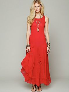 Easy, breezy FP maxi. Love the vibrant red and the embroidered cutout detail.