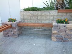 Corner bench. Just stack bricks, place wood... Decorate with flowers and maybe cushions.