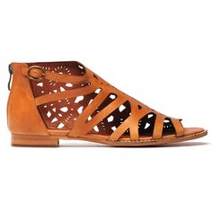 8b1177151dc A uniquely assymetrical laser cut sandal featuring an open toe design and a  back zip for easy wear. Leather upper