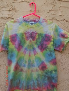 This 100% unique hand-dyed design was handmade in the US of A by Antho Jay of 710Visuals. Vibrant shades of pink, yellow, green, blue and more all blend together in a gorgeous array of color.  Pre-washed and pre-shrunk, guaranteed not to bleed.  No hippies were harmed in the making of this pr...