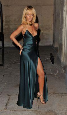 Feb 18 2012: Rihanna takes in the Stella McCartney Fall 2012 fashion show in a green silk Stella McCartney dress and Tom Ford sandals