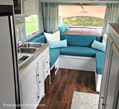 I love the colors that were used in this trailer makeover! Really beautiful. What a transformation!