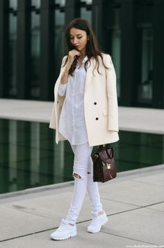 All white - sneakers, ripped jeans, blouse, cream blazer