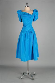 This is a dress that a girl in high school would have worn to prom. The puffed sleeves add a cute touch to the dress.