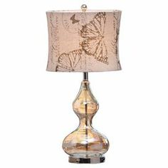 "Topped with a butterfly-printed linen shade, this vintage-style table lamp showcases a curvaceous glass base and sleek amber finish.      Product: Table lampConstruction Material: Glass and linenColor: Natural and amberAccommodates: (1) Bulb - not includedDimensions: 26"" H x 13"" Diameter"