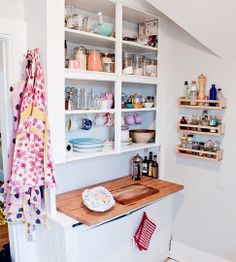 Can get this look by removing stock cabinet doors and installing cup hooks - great idea for renters!