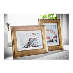 will not discolor the picture. You can hang the frame on a wall or stand it on a table.